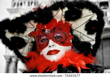 Carnival of Venice Portrait colorful and traditional Venetian mask - stock photo