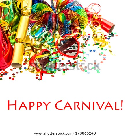 carnival party decorations garlands, confetti, streamer, cracker, glasses. festive background with sample text Happy Carnival! - stock photo