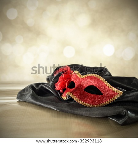 carnival red mask on black space and golden decoration  - stock photo