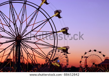Carnival rides at the state fair - stock photo