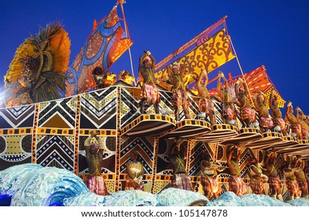 CARNIVAL RIO DE JANEIRO - FEBRUARY 19: Unidos da Vila Isabel samba school  float at the Sambadome, Rio de Janeiro, Brazil, February 19, 2012 . The Rio Carnival is the biggest carnival in the world. - stock photo