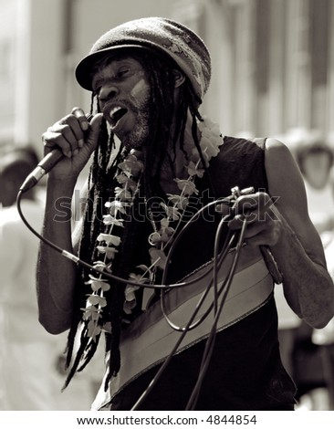 Carnival Singer, singing with feeling - sepia