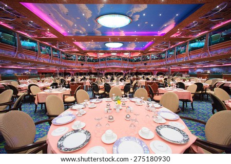 "CARNIVAL ""VALOR"" - 4AM. JUNE 5, 2008: Cruise ship main dining room for over 1,000 seats is awaiting for new guests. - stock photo"