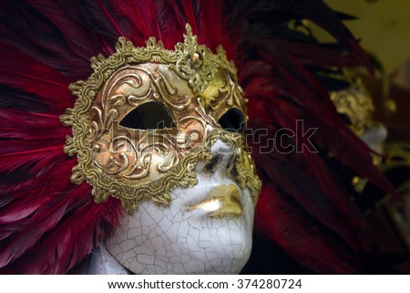 Carnival venetian mask with red feather
