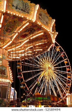Carousel and Ferris Wheel at Night - stock photo