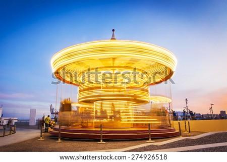 Carousel at evening. Long Exposure. - stock photo