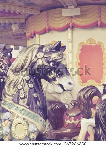 Carousel Horses in retro style focused on horse - stock photo