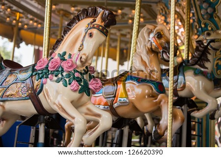 Carousel. Horses on a carnival Merry Go Round. - stock photo
