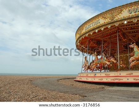 Carousel on Beach - stock photo