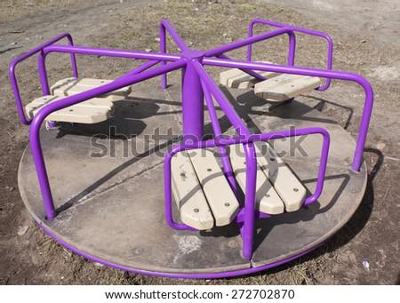 Carousel on playground - stock photo