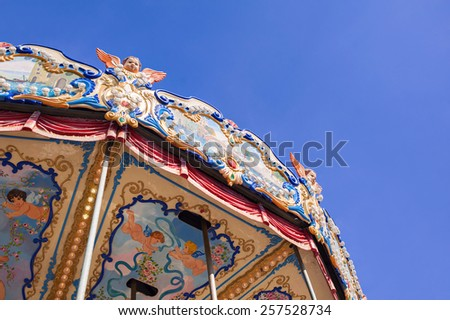 Carousel over a blue sky - stock photo