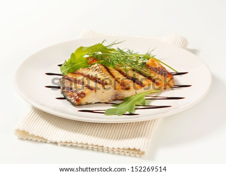 carp fillet served with herbs - stock photo