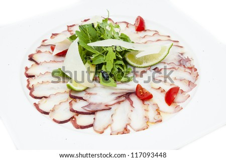 carpaccio of octopus in a restaurant on a white background