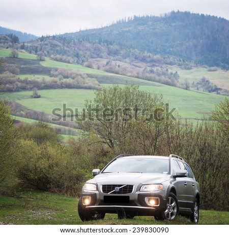 Carpathian mountain May 3, 2013 : Volvo XC 70  test drive on May 3, 2013 in Ukraine - stock photo
