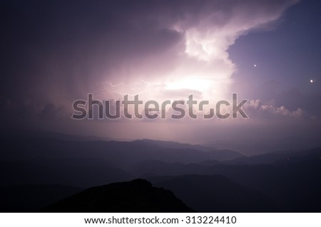 Carpathian Mountains. Mount Pop Ivan. Thunderhead and the starry sky above the ridge Montenegrin - stock photo