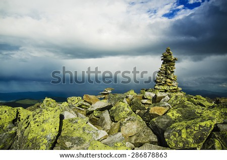 Carpathian mountains summer  landscape with dramatic clouds and mossy stones