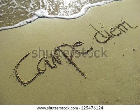 Carpe Diem Phrase in Sand on the Beach - stock photo
