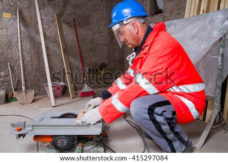 carpenter at work in a building site