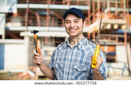 Carpenter at work in a construction site - stock photo