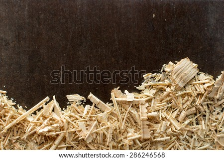Carpenter background. Table with sawdust. Carpenter workplace top view - stock photo