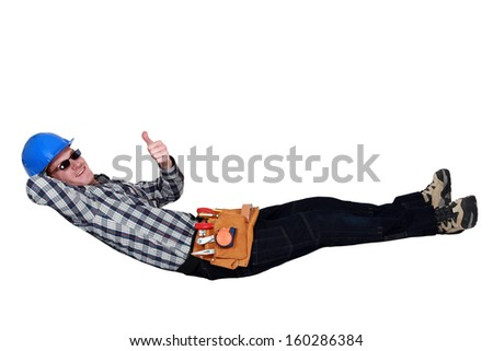 Carpenter chilling-out during break - stock photo
