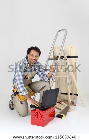Carpenter contact his customers via the Internet - stock photo