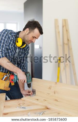 Carpenter creating new furniture   - stock photo