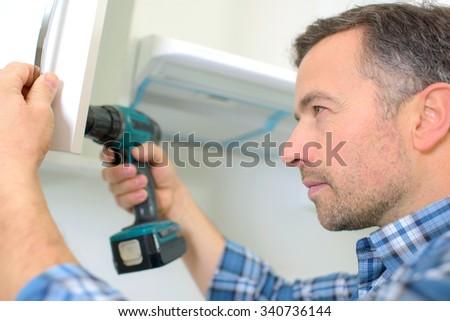 Carpenter drilling - stock photo
