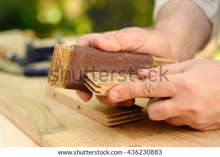 Carpenter hands at work with wood