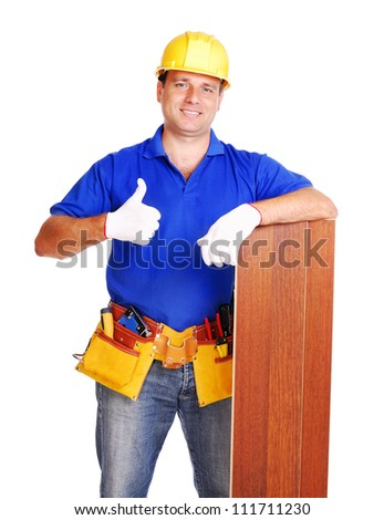 Carpenter holding the floor panel on white background showing thumbs up - stock photo