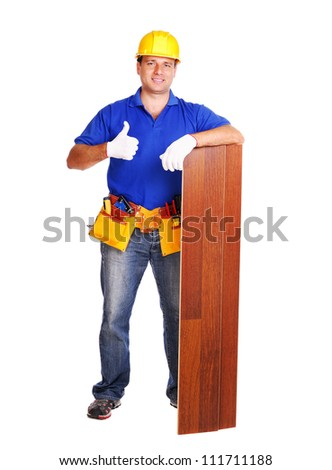 Carpenter holding the floor panel on white background showing thumbs up full length portrait - stock photo