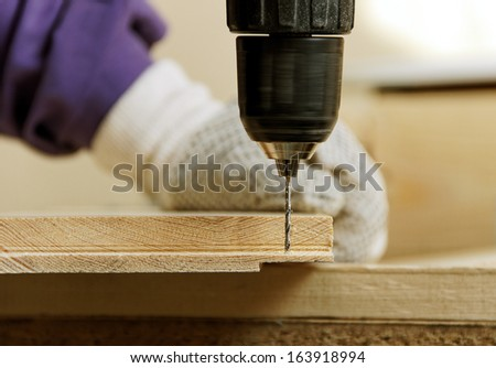 Carpenter is working with drill. - stock photo