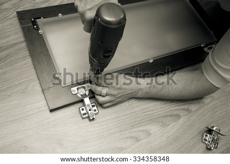 carpenter make new furniture for house - stock photo