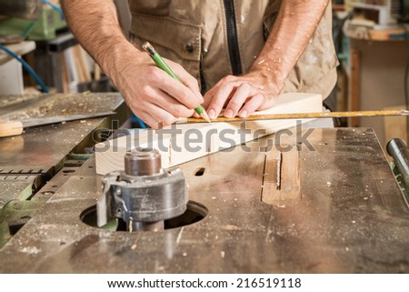 carpenter mark a wood plank - stock photo
