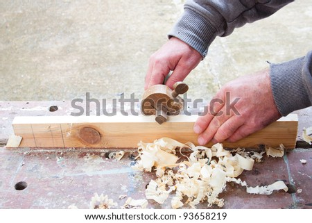 carpenter marking out wood
