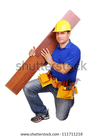 Carpenter on white background holding the floor board on his shoulder - stock photo
