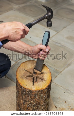 Carpenter performs chisel the internal cavity of the birdhouse - stock photo