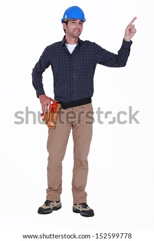Carpenter pointing into the distance - stock photo