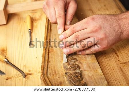 Carpenter restoring old furniture - stock photo