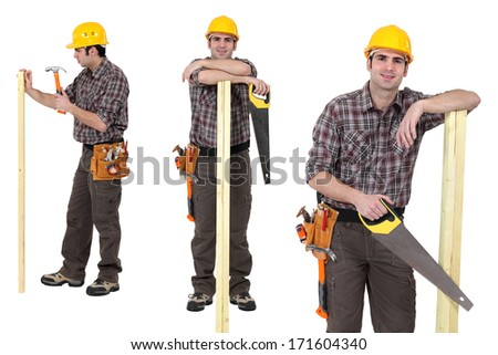 Carpenter standing with plank of wood and handsaw