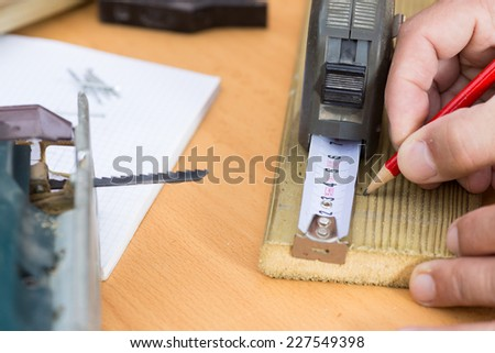 Carpenter taking action on a wooden slat - stock photo