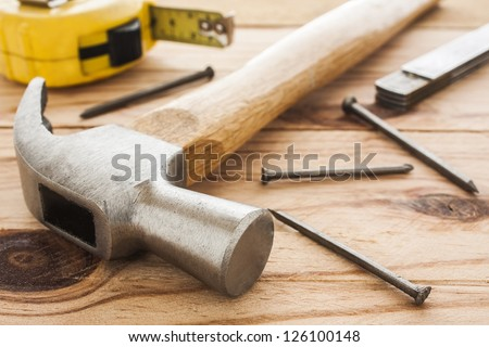 carpenter tools: hummer, tape measure, ruller and nails - stock photo