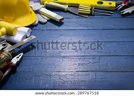Carpenter Tools on Lightened Background    - stock photo