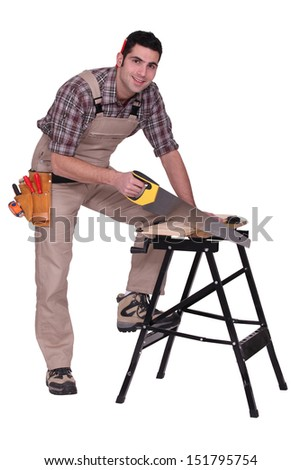 Carpenter using a handsaw