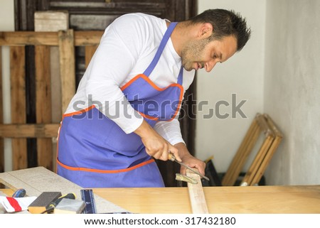 Carpenter using rasp in the carpentry
