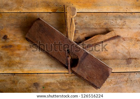 carpenter vintage wood planer tool planer rusted on retro  background - stock photo