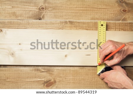 carpenter with a measuring tool and a pencil - stock photo