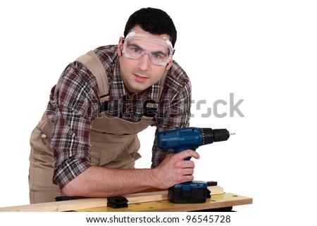 Carpenter with drill - stock photo