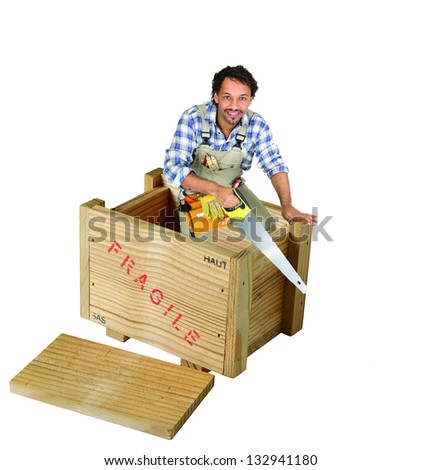 Carpenter with saw stood in wooden box - stock photo