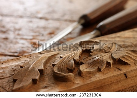 Carpenter wood chisel tool with carving  - stock photo